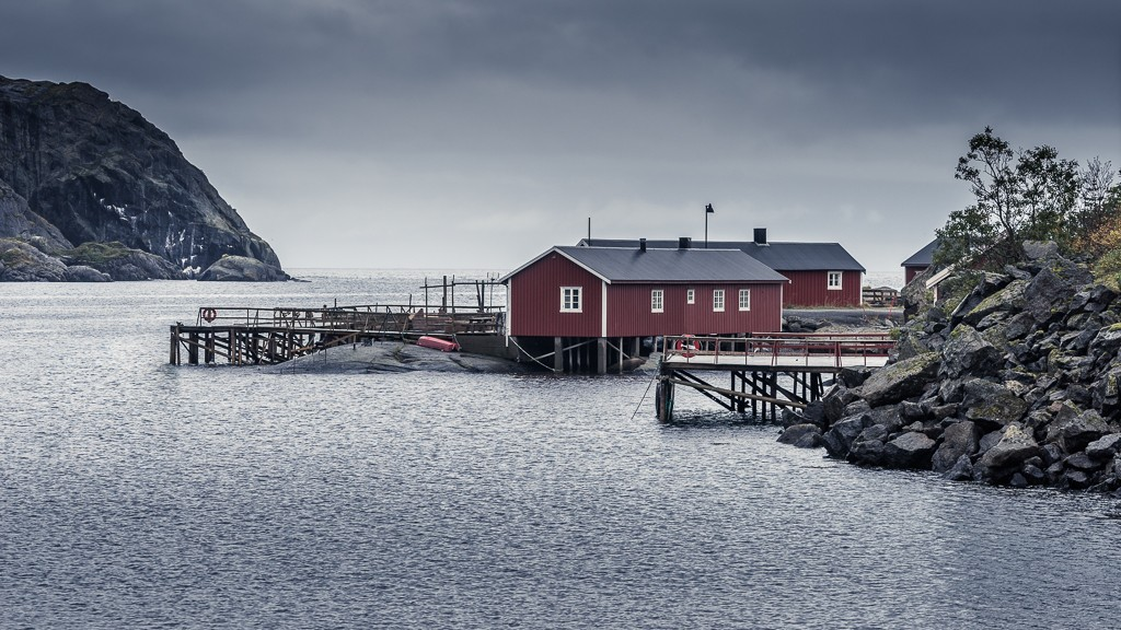Rorbu (fishing cabins) on the water approaching the village of Nusfjord
