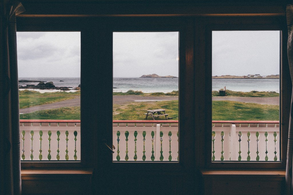 View of the beach from the window of a cabin at Ramberg