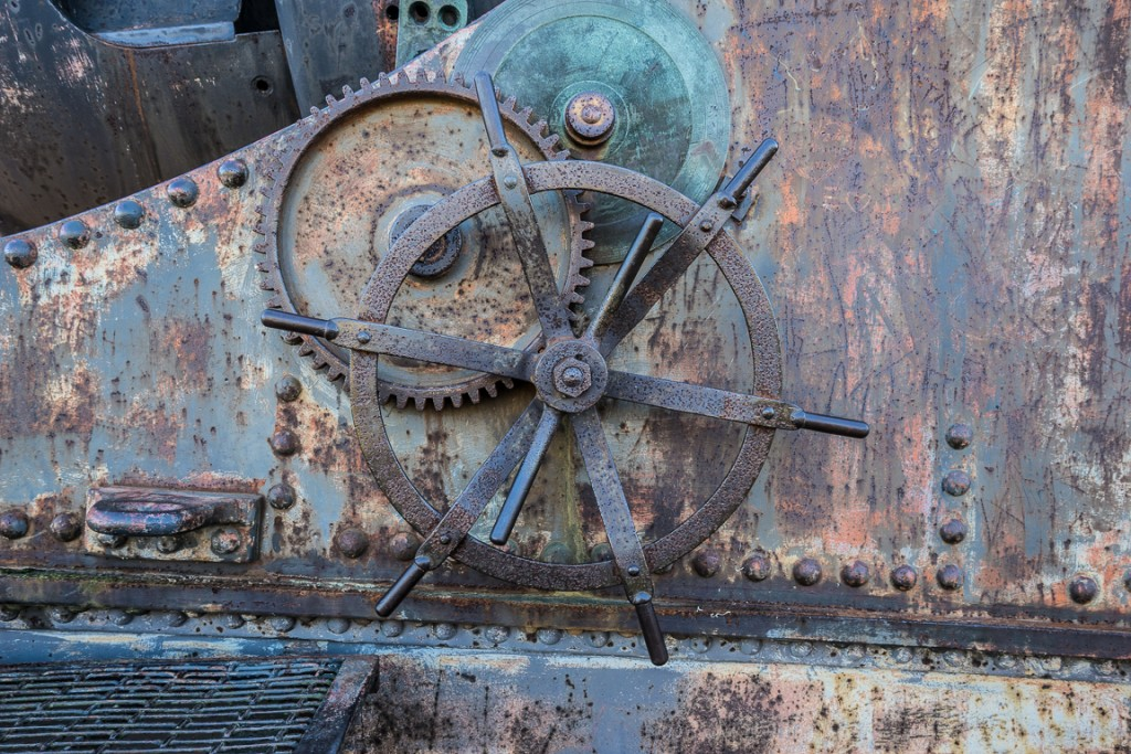Rusted wheels and metal on a coastal cannon