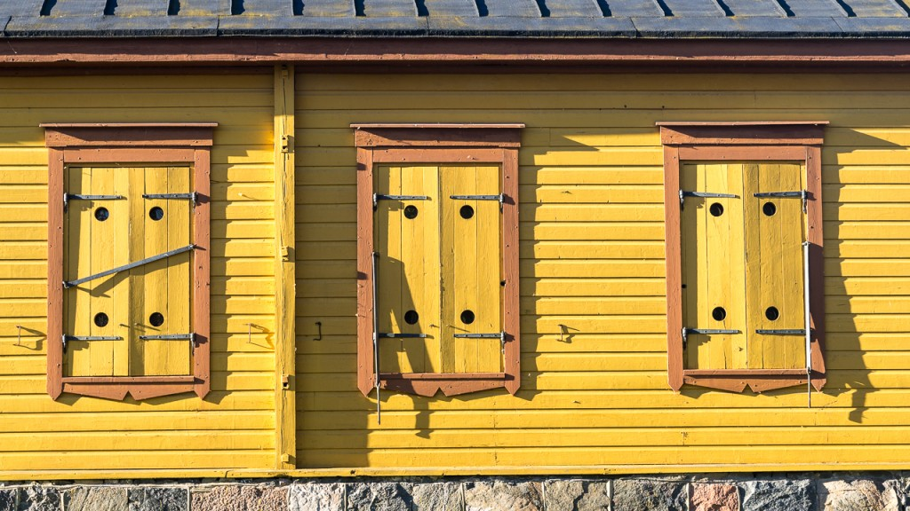 Yellow shutters on a wooden building