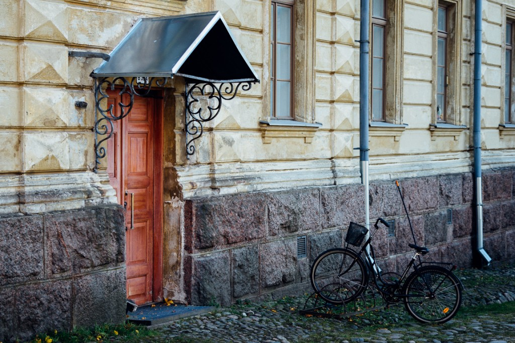 Bicycle outside one of the buildings in the courtyard