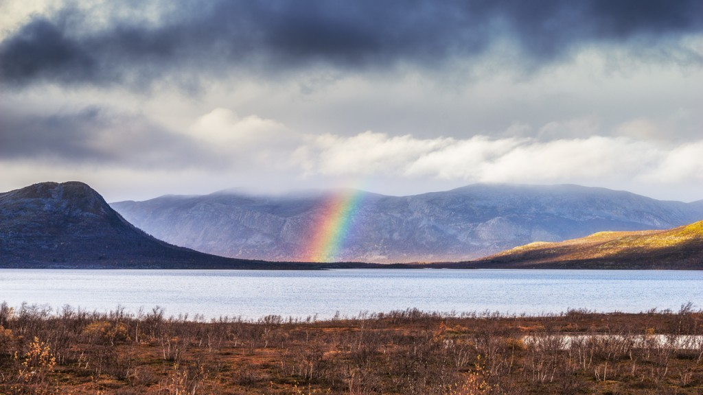 Rainbow over lake Torneträsk, northern Sweden.