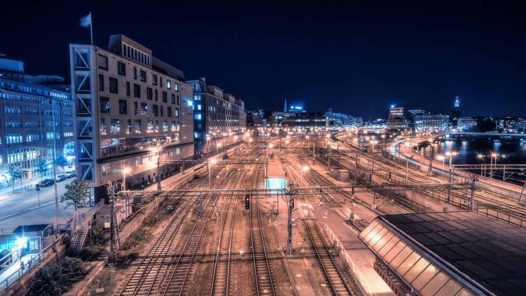 Train tracks leading to Stockholm Central Station at night