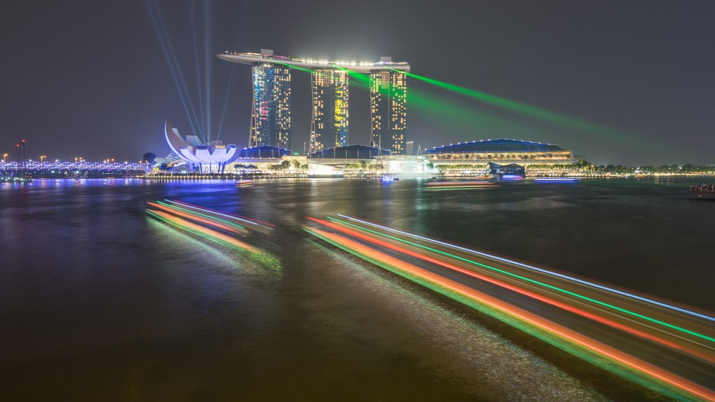 Light show at Marina Bay Sands, with light trails from the boats