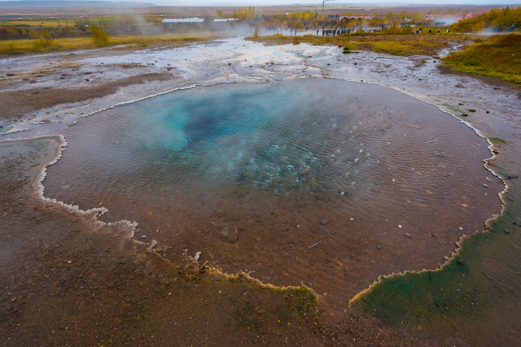 Colourful blue water of a small geothermal pool at Geysir