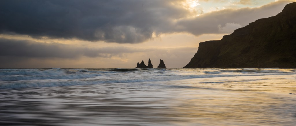 Rocks of Reynisdrangar viewed from Vik beach at sunset.