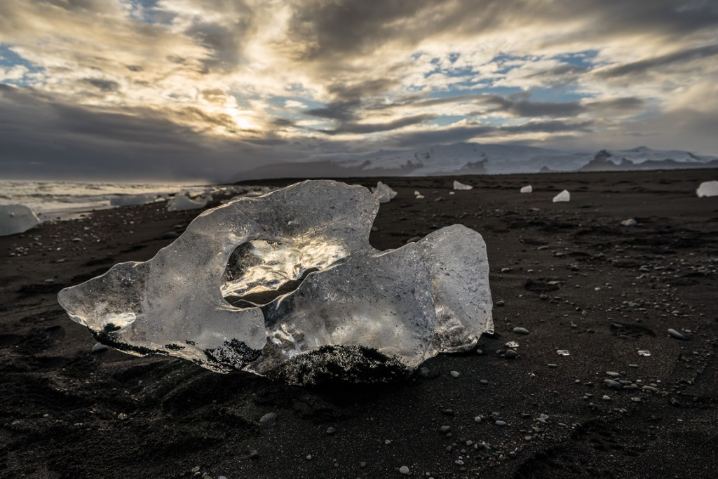 Lumps of ice on the black sand beach at Jökulsárlón.